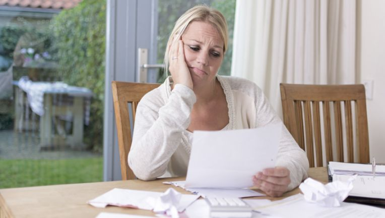 77a1f04e-Stressed-woman-planning-finances-bills-and-debt