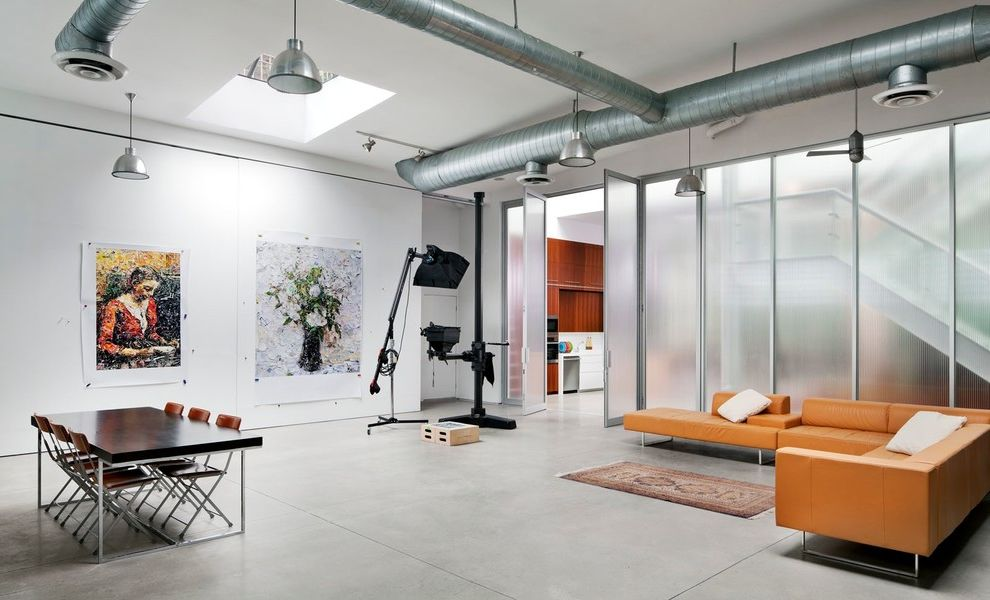 how-often-to-clean-air-ducts-industrial-home-office-also-exposed-ducts-orange-sectional-sofa-pendant-lights-polished-concrete-floor-studio-transparent-wall