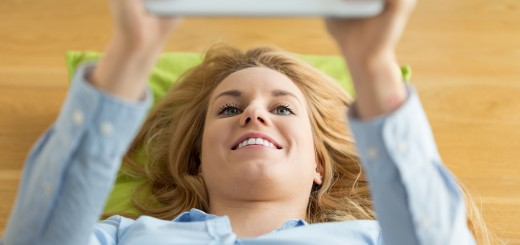 Woman using tablet in the morning, horizontal